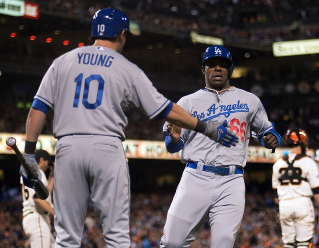 Sep 25, 2013; San Francisco, CA, USA; Los Angeles Dodgers third baseman Michael Young (10) congratulates right fielder Yasiel Puig (66) after he scored against the San Francisco Giants during the fourth inning at AT&T Park. Mandatory Credit: Ed Szczepanski-USA TODAY Sports