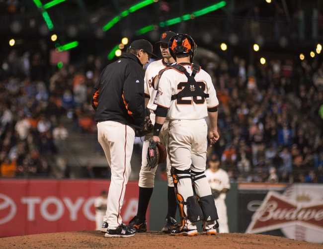 Sep 25, 2013; San Francisco, CA, USA; San Francisco Giants pitching coach Dave Righetti (33) visits the mound to talk with starting pitcher Barry Zito (75) during the fourth inning of the game against the Los Angeles Dodgers at AT&T Park. Mandatory Credit: Ed Szczepanski-USA TODAY Sports
