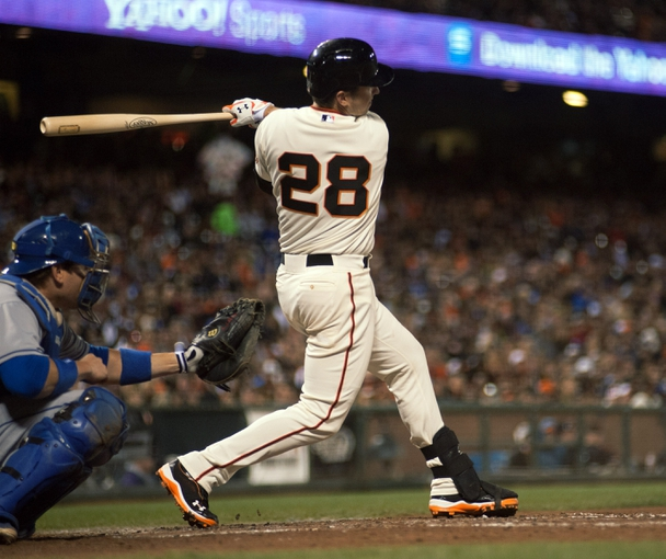 Sep 25, 2013; San Francisco, CA, USA; San Francisco Giants catcher Buster Posey (28) hits a single against the Los Angeles Dodgers during the fourth inning at AT&T Park. Mandatory Credit: Ed Szczepanski-USA TODAY Sports