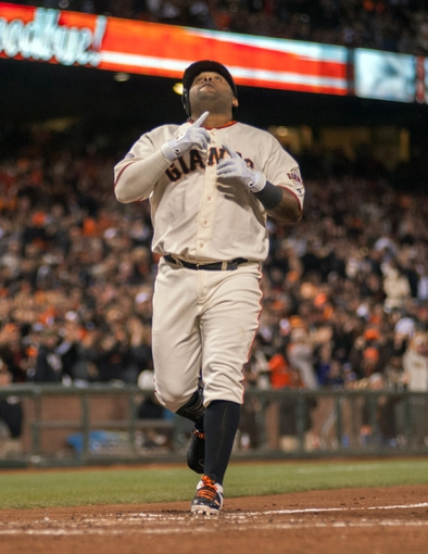 Sep 25, 2013; San Francisco, CA, USA; San Francisco Giants third baseman Pablo Sandoval (48) points to the sky after hitting a home run against the Los Angeles Dodgers during the fourth inning at AT&T Park. Mandatory Credit: Ed Szczepanski-USA TODAY Sports