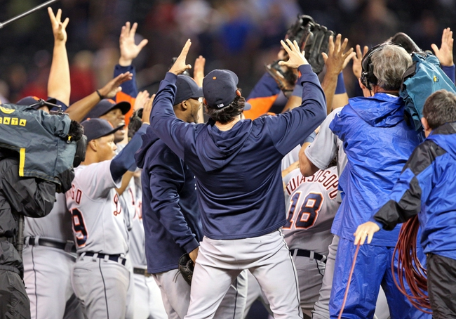 Sep 25, 2013; Minneapolis, MN, USA; Detroit Tigers celebrate after beating the Minnesota Twins and winning the American League central division championship at Target Field. The Tigers won 1-0. Mandatory Credit: Jesse Johnson-USA TODAY Sports
