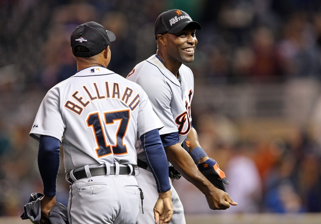 Sep 25, 2013; Minneapolis, MN, USA; Detroit Tigers right fielder Torii Hunter (48) and first base coach Rafael Belliard (17) celebrate after beating the Minnesota Twins and winning the American League central division championship at Target Field. The Tigers won 1-0. Mandatory Credit: Jesse Johnson-USA TODAY Sports