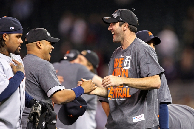 Sep 25, 2013; Minneapolis, MN, USA; Detroit Tigers starting pitcher Justin Verlander (35) celebrates after beating the Minnesota Twins and winning the American League central division championship at Target Field. The Tigers won 1-0. Mandatory Credit: Jesse Johnson-USA TODAY Sports