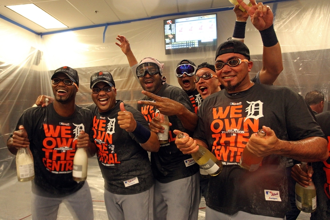 Sep 25, 2013; Minneapolis, MN, USA; Detroit Tigers players pose for a photo in the locker room after beating the Minnesota Twins for the American League Central Division Championship at Target Field. The Tigers won 1-0. Mandatory Credit: Jesse Johnson-USA TODAY Sports