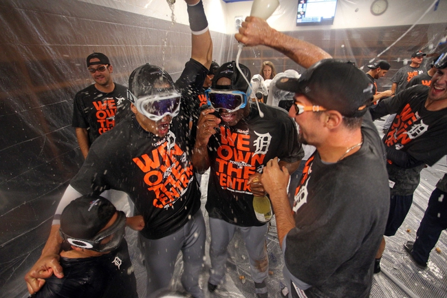 Sep 25, 2013; Minneapolis, MN, USA; Detroit Tigers celebrate with champagne after beating the Minnesota Twins to win the American Central Division Championship at Target Field. The Tigers won 1-0. Mandatory Credit: Jesse Johnson-USA TODAY Sports