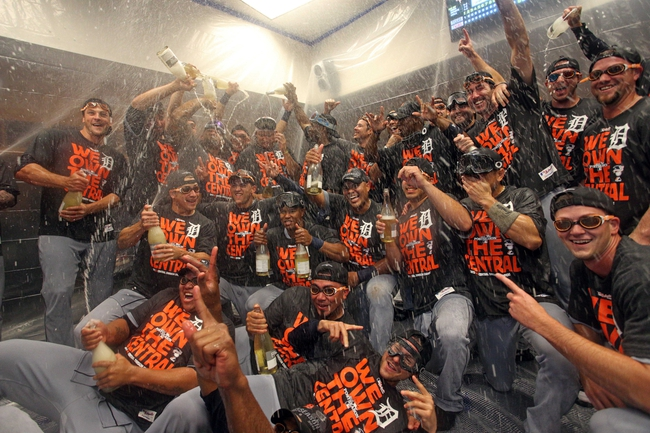 Sep 25, 2013; Minneapolis, MN, USA; Detroit Tigers team poses for a photo during the post game celebration of winning the American League Central Division Championship at Target Field. The Tigers won 1-0. Mandatory Credit: Jesse Johnson-USA TODAY Sports