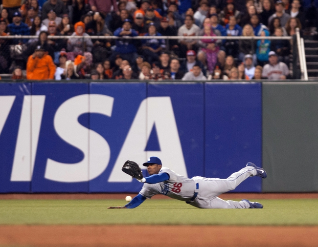 Sep 25, 2013; San Francisco, CA, USA; Los Angeles Dodgers right fielder Yasiel Puig (66) is unable to make the catch against the San Francisco Giants during the sixth inning at AT&T Park. Mandatory Credit: Ed Szczepanski-USA TODAY Sports