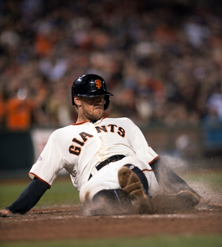 Sep 25, 2013; San Francisco, CA, USA; San Francisco Giants right fielder Hunter Pence (8) slides into home plate during the sixth inning against the Los Angeles Dodgers at AT&T Park. Mandatory Credit: Ed Szczepanski-USA TODAY Sports