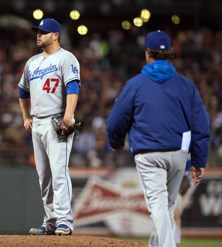 Sep 25, 2013; San Francisco, CA, USA; Los Angeles Dodgers starting pitcher Ricky Nolasco (47) reacts after being taken out of the game during the sixth inning of the game against the San Francisco Giants at AT&T Park. Mandatory Credit: Ed Szczepanski-USA TODAY Sports