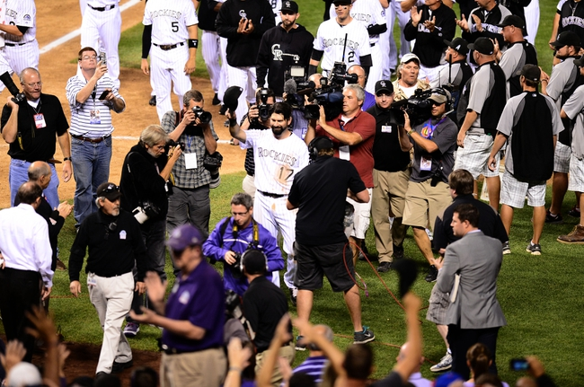 Sep 25, 2013; Denver, CO, USA; Colorado Rockies first baseman Todd Helton (17) tips his hat to the crowd following the loss to the Boston Red Sox at Coors Field. The Red Sox defeated the Rockies 15-5. Mandatory Credit: Ron Chenoy-USA TODAY Sports
