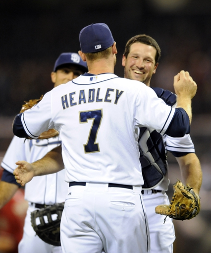 Sep 25, 2013; San Diego, CA, USA; San Diego Padres catcher Chris Robinson (8) celebrates with third baseman Chase Headley (7) after a 12-2 win against the Arizona Diamondbacks at Petco Park. Mandatory Credit: Christopher Hanewinckel-USA TODAY Sports