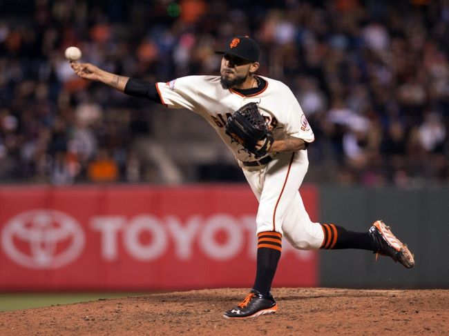 Sep 25, 2013; San Francisco, CA, USA; San Francisco Giants relief pitcher Sergio Romo (54) pitches against the Los Angeles Dodgers during the ninth inning at AT&T Park. The San Francisco Giants defeated the Los Angeles Dodgers 6-4. Mandatory Credit: Ed Szczepanski-USA TODAY Sports
