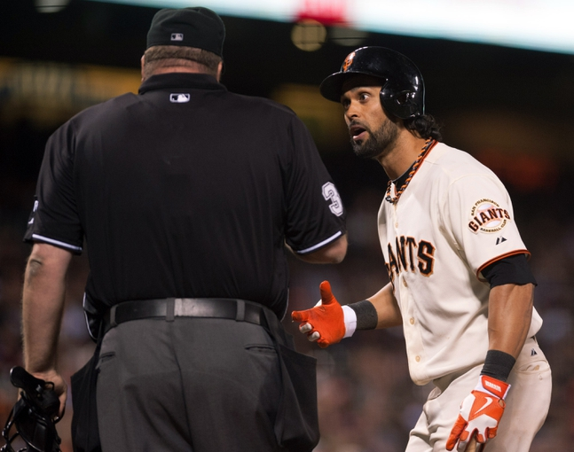 Sep 25, 2013; San Francisco, CA, USA; San Francisco Giants center fielder Angel Pagan (16) argues a call with the home plate umpire during the seventh inning at AT&T Park. The San Francisco Giants defeated the Los Angeles Dodgers 6-4. Mandatory Credit: Ed Szczepanski-USA TODAY Sports