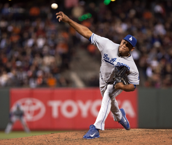 Sep 25, 2013; San Francisco, CA, USA; Los Angeles Dodgers relief pitcher Carlos Marmol (49) pitches against the San Francisco Giants during the eighth inning at AT&T Park. The San Francisco Giants defeated the Los Angeles Dodgers 6-4. Mandatory Credit: Ed Szczepanski-USA TODAY Sports