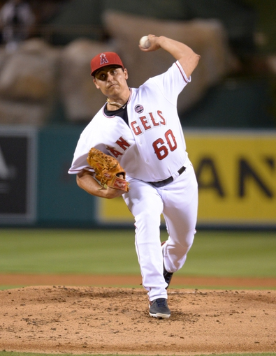 Sep 24, 2013; Anaheim, CA, USA; Los Angeles Angels starter Jason Vargas (60) delivers a pitch against the Oakland Athletics at Angel Stadium of Anaheim. Mandatory Credit: Kirby Lee-USA TODAY Sports