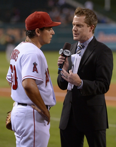 Sep 24, 2013; Anaheim, CA, USA; Fox Sports West broadcaster Kent French (right) interviews Los Angeles Angels pitcher Jason Vargas (60) after the game against the Oakland Athletics at Angel Stadium of Anaheim. Mandatory Credit: Kirby Lee-USA TODAY Sports