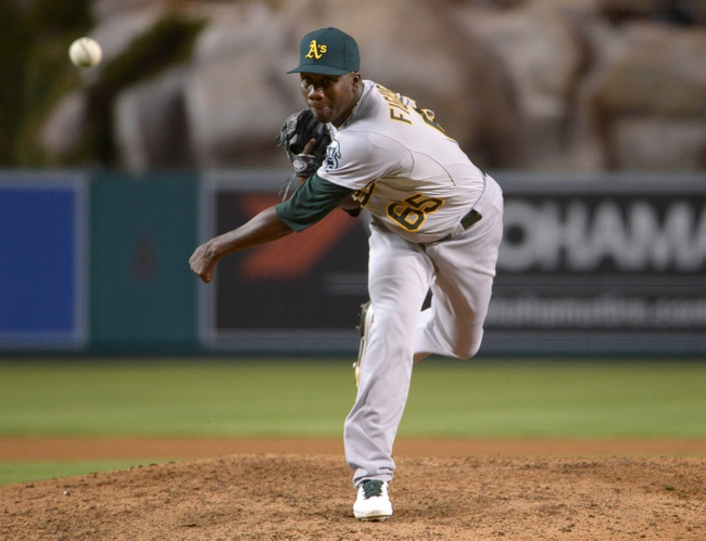 Sep 24, 2013; Anaheim, CA, USA; Oakland Athletics reliever Pedro Figueroa (65) delivers a pitch against the Los Angeles Angels at Angel Stadium of Anaheim. The Angels defeated the Athletics 3-0. Mandatory Credit: Kirby Lee-USA TODAY Sports