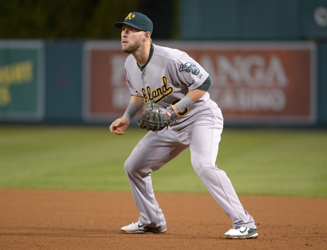 Sep 24, 2013; Anaheim, CA, USA; Oakland Athletics first baseman Daric Barton (10) during the game against the Los Angeles Angels at Angel Stadium of Anaheim. The Angels defeated the Athletics 3-0. Mandatory Credit: Kirby Lee-USA TODAY Sports