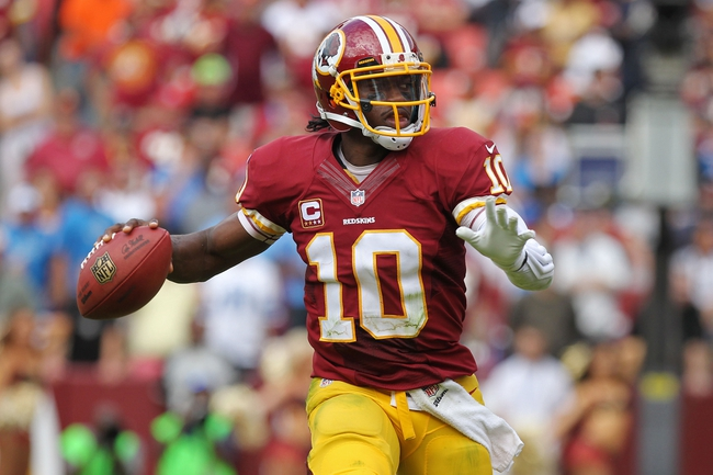 Sep 22, 2013; Landover, MD, USA; Washington Redskins quarterback Robert Griffin III (10) throws the ball against the Detroit Lions at FedEx Field. Mandatory Credit: Geoff Burke-USA TODAY Sports