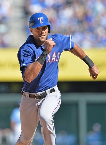 Sep 22, 2013; Kansas City, MO, USA; Texas Rangers base runner Alex Rios (51) runs to third base against the Kansas City Royals during the ninth inning at Kauffman Stadium. Mandatory Credit: Peter G. Aiken-USA TODAY Sports