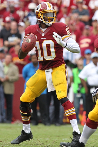 Sep 22, 2013; Landover, MD, USA; Washington Redskins quarterback Robert Griffin III (10) prepares to throw the ball against the Detroit Lions at FedEx Field. Mandatory Credit: Geoff Burke-USA TODAY Sports