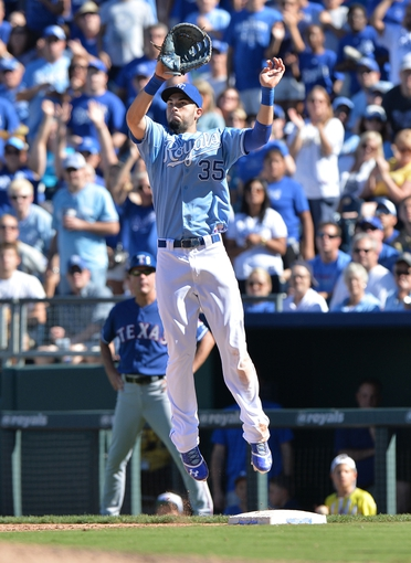 Sep 22, 2013; Kansas City, MO, USA; Kansas City Royals first basemen Eric Hosmer (35) leaps for a high throw at first against the Texas Rangers during the ninth inning at Kauffman Stadium. Mandatory Credit: Peter G. Aiken-USA TODAY Sports