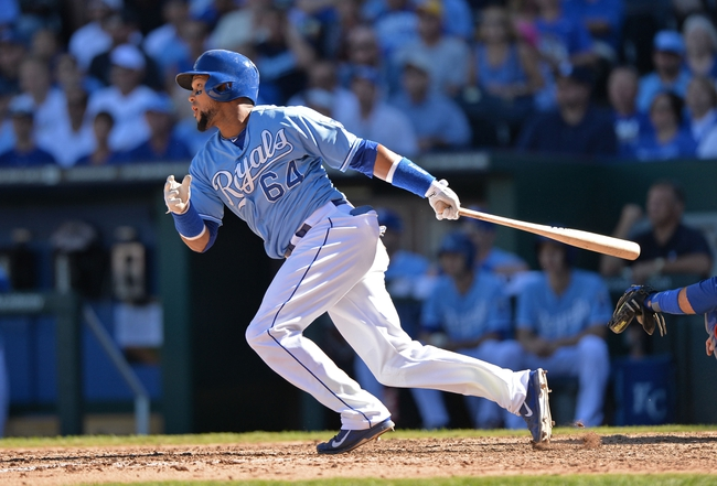 Sep 22, 2013; Kansas City, MO, USA; Kansas City Royals second basemen Emilio Bonifacio (64) at bat against the Texas Rangers during the ninth inning at Kauffman Stadium. Mandatory Credit: Peter G. Aiken-USA TODAY Sports
