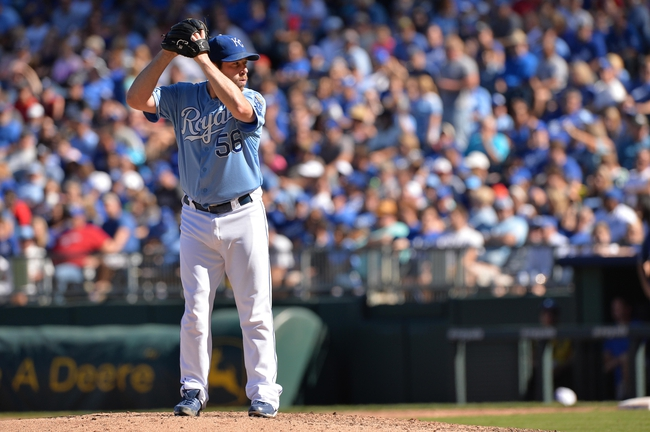 Sep 22, 2013; Kansas City, MO, USA; Kansas City Royals pitcher Greg Holland (56) gets set to deliver a pitch against the Texas Rangers during the ninth inning at Kauffman Stadium. Mandatory Credit: Peter G. Aiken-USA TODAY Sports
