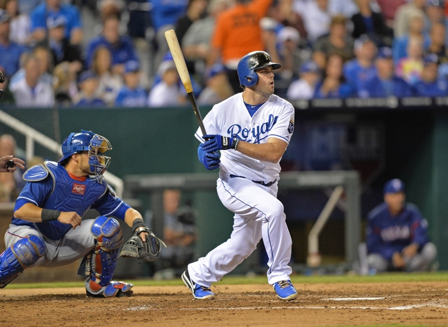 Sep 20, 2013; Kansas City, MO, USA; Kansas City Royals third basemen Mike Moustakas (8) at bat against the Texas Rangers during the second inning at Kauffman Stadium. Mandatory Credit: Peter G. Aiken-USA TODAY Sports