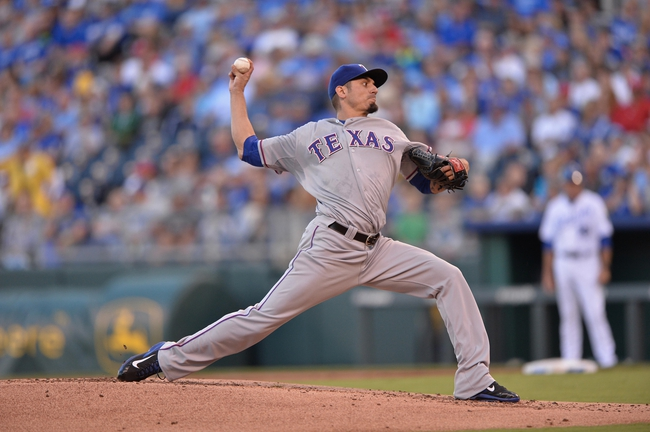Sep 21, 2013; Kansas City, MO, USA; Texas Rangers pitcher Matt Garza (22) delivers a pitch against the Kansas City Royals during the first inning at Kauffman Stadium. Mandatory Credit: Peter G. Aiken-USA TODAY Sports