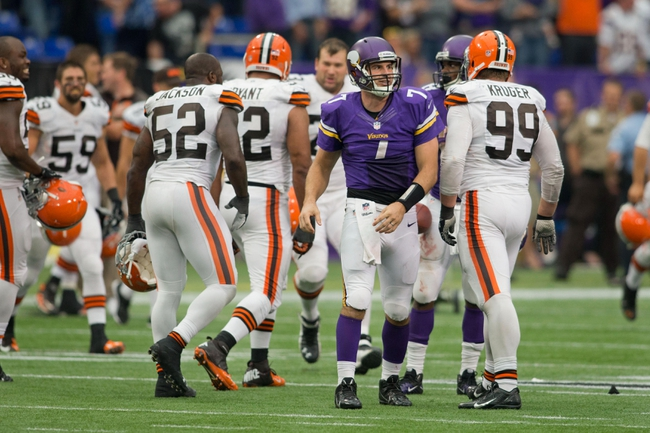 Sep 22, 2013; Minneapolis, MN, USA; Minnesota Vikings quarterback Christian Ponder (7) gets up after being sacked by the Cleveland Browns to end the game at Mall of America Field at H.H.H. Metrodome. The Browns win 31-27. Mandatory Credit: Bruce Kluckhohn-USA TODAY Sports