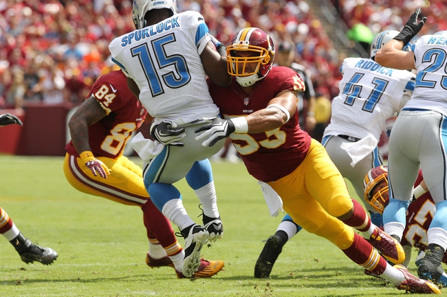 Sep 22, 2013; Landover, MD, USA; Washington Redskins linebacker Bryan Kehl (53) tackles Detroit Lions wide receiver Micheal Spurlock (15) at FedEx Field. Mandatory Credit: Geoff Burke-USA TODAY Sports