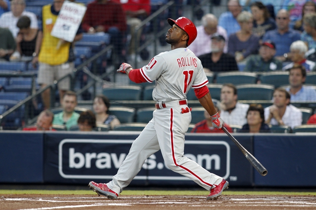 Sep 26, 2013; Atlanta, GA, USA; Philadelphia Phillies shortstop Jimmy Rollins (11) hits a single against the Atlanta Braves in the first inning at Turner Field. Mandatory Credit: Brett Davis-USA TODAY Sports