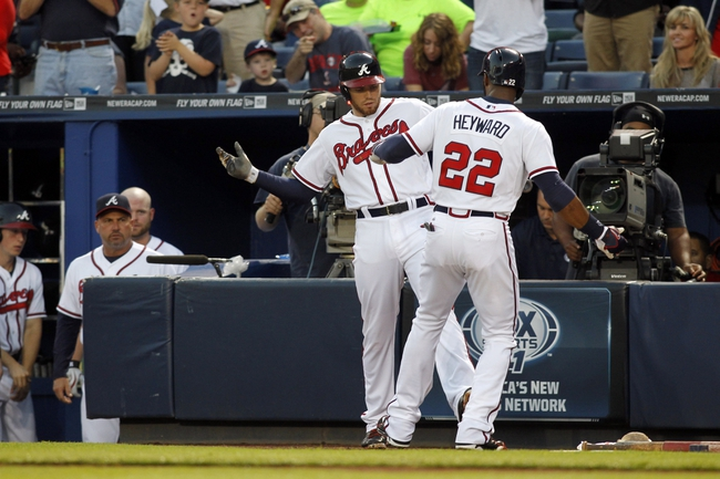 Sep 26, 2013; Atlanta, GA, USA; Atlanta Braves first baseman Freddie Freeman (5) and right fielder Jason Heyward (22) celebrate after a home run against the Philadelphia Phillies in the first inning at Turner Field. Mandatory Credit: Brett Davis-USA TODAY Sports