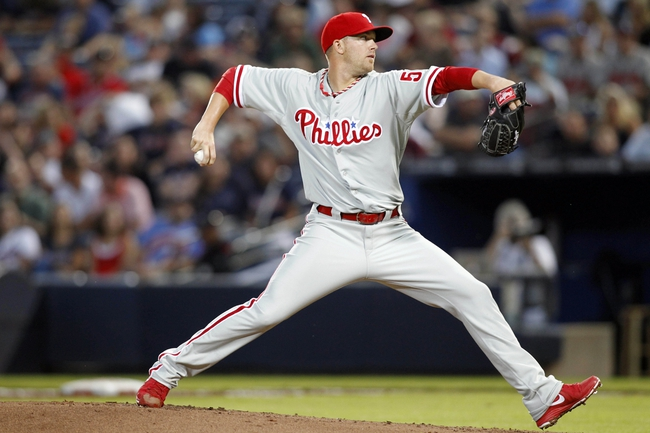 Sep 26, 2013; Atlanta, GA, USA; Philadelphia Phillies starting pitcher Tyler Cloyd (50) throws a pitch against the Atlanta Braves in the first inning at Turner Field. Mandatory Credit: Brett Davis-USA TODAY Sports