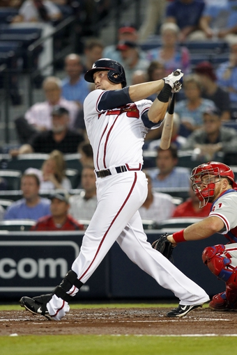 Sep 26, 2013; Atlanta, GA, USA; Atlanta Braves third baseman Chris Johnson (23) hits a RBI double against the Philadelphia Phillies in the first inning at Turner Field. Mandatory Credit: Brett Davis-USA TODAY Sports