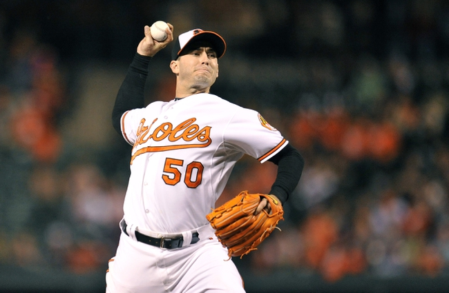 Sep 26, 2013; Baltimore, MD, USA; Baltimore Orioles starting pitcher Miguel Gonzalez (50) throws in the third inning against the Toronto Blue Jays at Oriole Park at Camden Yards. Mandatory Credit: Joy R. Absalon-USA TODAY Sports