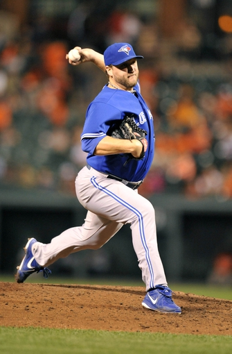 Sep 26, 2013; Baltimore, MD, USA; Toronto Blue Jays starting pitcher Mark Buehrle (56) throws in the third inning against the Baltimore Orioles at Oriole Park at Camden Yards. Mandatory Credit: Joy R. Absalon-USA TODAY Sports