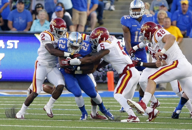 Sep 26, 2013; Tulsa, OK, USA; Tulsa Golden Hurricane running back Trey Watts (22) is caught between Iowa State Cyclones Jansen Watson (2) and Jacques Washington (5) during the first half of a college football game at Skelly Field at H.A. Chapman Stadium. Mandatory Credit: Alonzo Adams-USA TODAY Sports