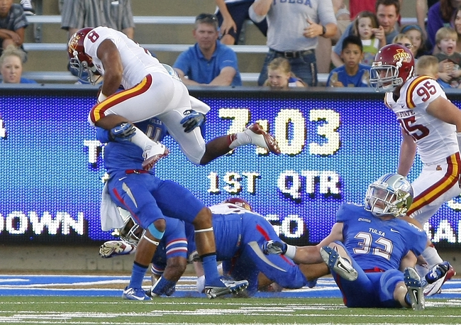 Sep 26, 2013; Tulsa, OK, USA; Tulsa Golden Hurricane Darnell Walker Jr. (4) stops Iowa State Cyclones James White (8) before he enters the end zone during the first half of a NCAA college football game at Skelly Field at H.A. Chapman Stadium. Mandatory Credit: Alonzo Adams-USA TODAY Sports