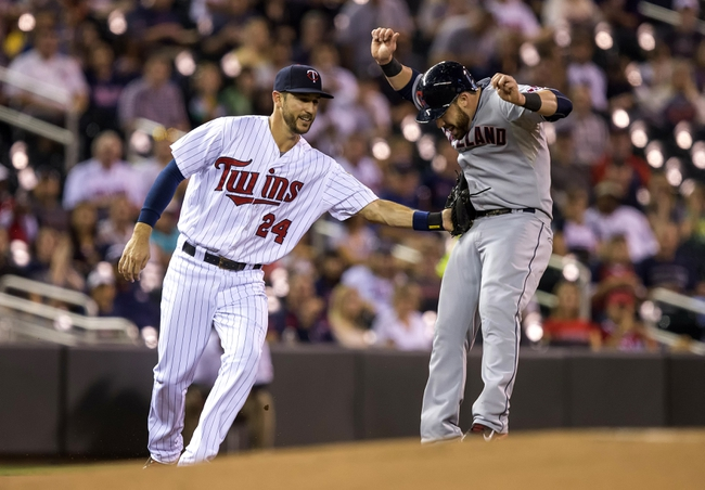 Sep 26, 2013; Minneapolis, MN, USA; Minnesota Twins third baseman Trevor Plouffe (24) tags out Cleveland Indians second baseman Jason Kipnis (22) on a fielders choice in first inning at Target Field. Mandatory Credit: Jesse Johnson-USA TODAY Sports