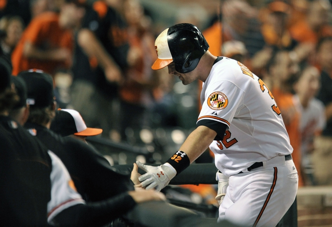 Sep 26, 2013; Baltimore, MD, USA; Baltimore Orioles catcher Matt Wieters (32) is congratulated by teammates after hitting a solo home run in the second inning against the Toronto Blue Jays at Oriole Park at Camden Yards. Mandatory Credit: Joy R. Absalon-USA TODAY Sports
