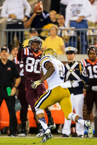 Sep 26, 2013; Atlanta, GA, USA; Virginia Tech Hokies wide receiver Demitri Knowles (80) catches a pass over Georgia Tech Yellow Jackets cornerback Louis Young (8) in the first half at Bobby Dodd Stadium. Mandatory Credit: Daniel Shirey-USA TODAY Sports