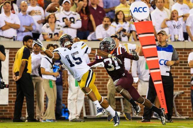 Sep 26, 2013; Atlanta, GA, USA; Georgia Tech Yellow Jackets wide receiver DeAndre Smelter (15) reaches for an overthrown ball with coverage by Virginia Tech Hokies cornerback Brandon Facyson (31) in the first half at Bobby Dodd Stadium. Mandatory Credit: Daniel Shirey-USA TODAY Sports