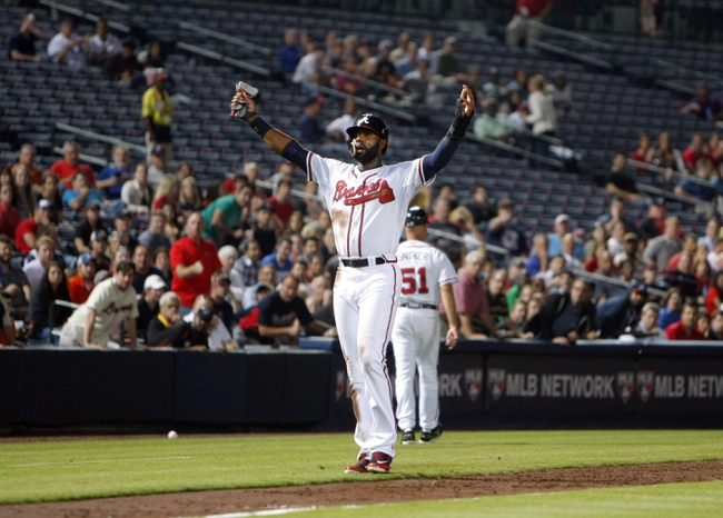 Sep 26, 2013; Atlanta, GA, USA; Atlanta Braves right fielder Jason Heyward (22) reacts after almost being hit by a foul ball off of the bat of left fielder Evan Gattis (not pictured) against the Philadelphia Phillies in the third inning at Turner Field. Mandatory Credit: Brett Davis-USA TODAY Sports
