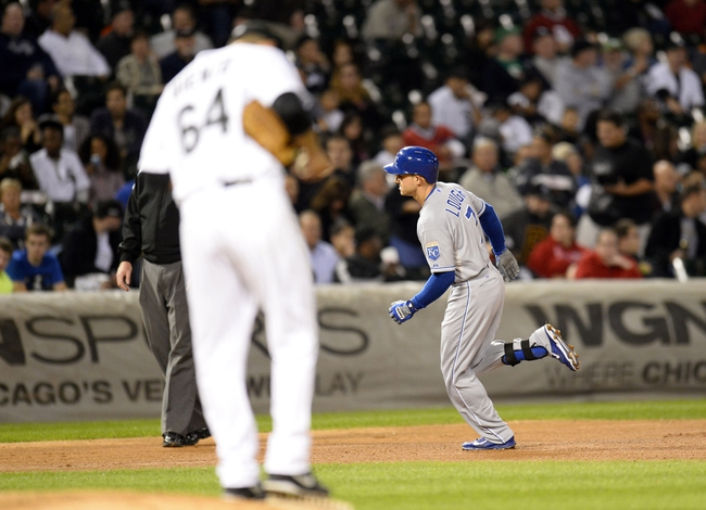 Sep 26, 2013; Chicago, IL, USA; Kansas City Royals right fielder David Lough (7) runs the bases on a two run home run against Chicago White Sox starting pitcher Andre Rienzo (64) during the fourth inning at U.S Cellular Field. Mandatory Credit: Mike DiNovo-USA TODAY Sports