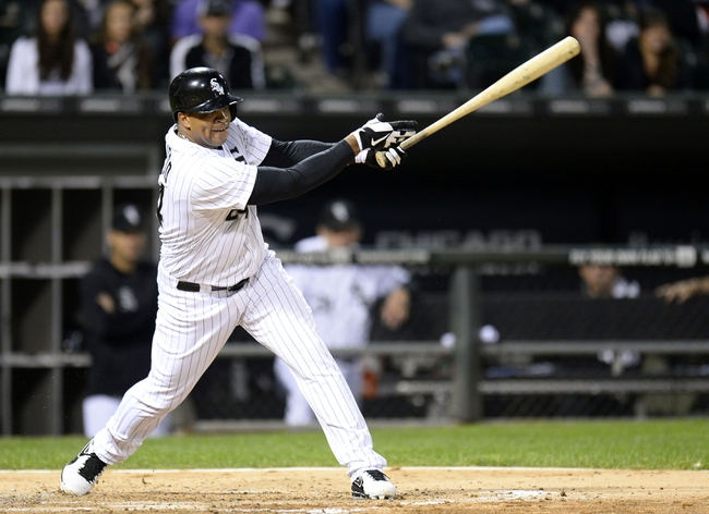 Sep 26, 2013; Chicago, IL, USA; Chicago White Sox left fielder Dayan Viciedo (24) hits a double against the Kansas City Royals during the fourth inning at U.S Cellular Field. Mandatory Credit: Mike DiNovo-USA TODAY Sports