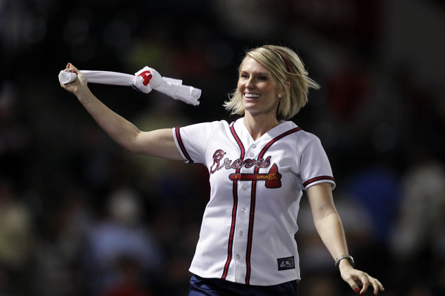 Sep 26, 2013; Atlanta, GA, USA; Atlanta Braves tomahawk team member dances on the dugout against the Philadelphia Phillies in the seventh inning at Turner Field. Mandatory Credit: Brett Davis-USA TODAY Sports
