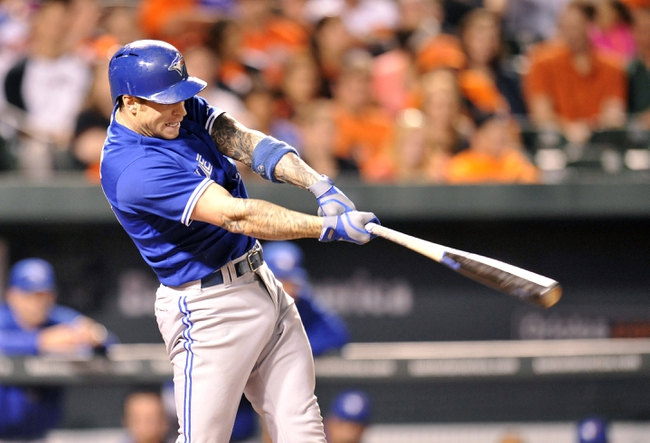 Sep 26, 2013; Baltimore, MD, USA; Toronto Blue Jays third baseman Brett Lawrie (13) hits a one-run rbi double in in the eighth inning against the Baltimore Orioles at Oriole Park at Camden Yards. The Orioles defeated the Blue Jays 3-2. Mandatory Credit: Joy R. Absalon-USA TODAY Sports