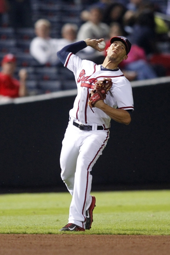 Sep 26, 2013; Atlanta, GA, USA; Atlanta Braves shortstop Andrelton Simmons (19) throws a runner out at first against the Philadelphia Phillies in the ninth inning at Turner Field. The Braves defeated the Phillies 7-1. Mandatory Credit: Brett Davis-USA TODAY Sports